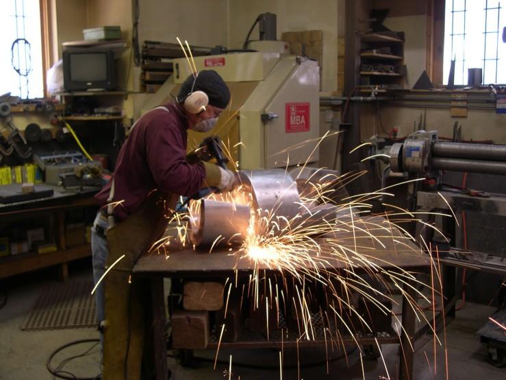 Frank Morbillo Sanding a Sculpture- Matthews Gallery Blog