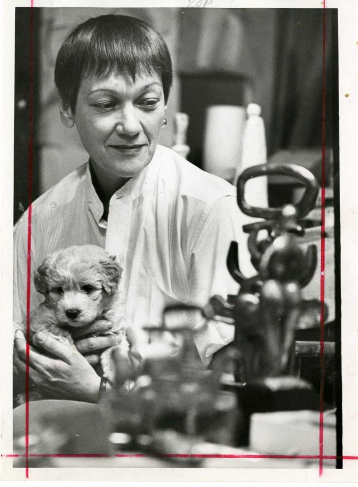 Sculptor Hannah Stewart with her cocker-poodle, Major, in 1967- Houston Chronicle